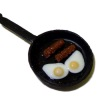 Bette Accola Handcrafted Sausage and Eggs in Frying Pan