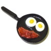 Handcrafted Bacon and Eggs In Frying Pan