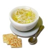 Handcrafted Chicken Noodle Soup with Spoon And Crackers