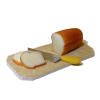 Handcrafted Bread Loaf with Slices On Cutting Board