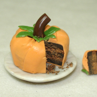 Handcrafted Halloween Pumpkin Cake with a Slice