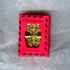 Opening Box of Gold Metallic Christmas Ornaments