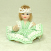 Porcelain Toddler Girl Doll in Green Crisscross Dress