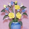 Blue and Yellow Flower Arrangement in Glazed Ceramic Vase
