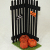 Handcrafted Halloween Fence Scene with Pumpkins