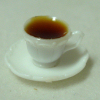 Mary Eccher Filled Cup of Coffee with Saucer