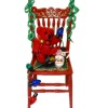 Decorated Red Christmas Chair With Teddy Bear and Santa Mug