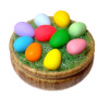 Colored Easter Eggs in Wood Bowl with Grass