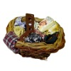 Filled Wicker Laundry Basket with Antique Sock Stretcher Form
