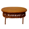 Wilhelmina Oval Wood Coffee Table With Wicker Accent